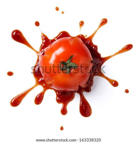 splattered tomato with ketchup isolated on white background - stock photo