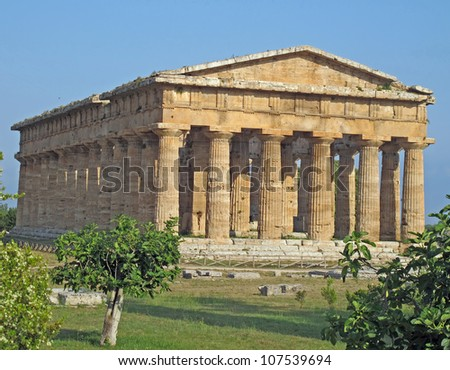 splendid ancient Greek columns of the temple very well preserved in Italy - stock photo