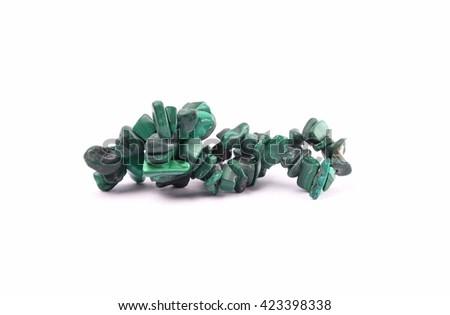 Splintered malachite chain on white background - stock photo