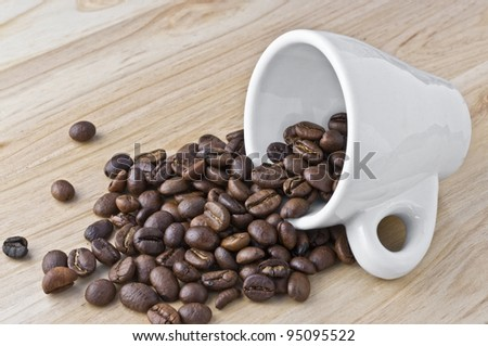 Split coffee beans isolated in wood background