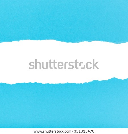 split halves of the sheet of red ripped paper on white background - stock photo