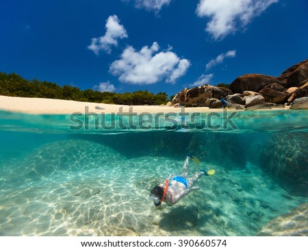 Split photo of young woman snorkeling in turquoise tropical water among huge granite boulders at The Baths beach area major tourist attraction on Virgin Gorda, British Virgin Islands, Caribbean - stock photo