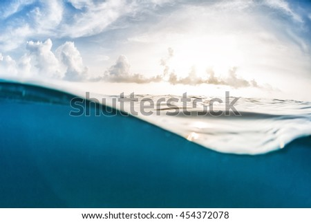 Split shot of the sea surface and cloudy sky
