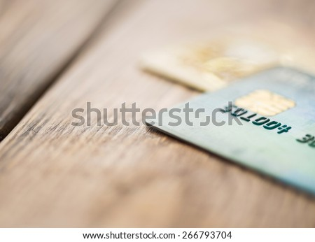 Split toned macro image of credit cards up close - stock photo