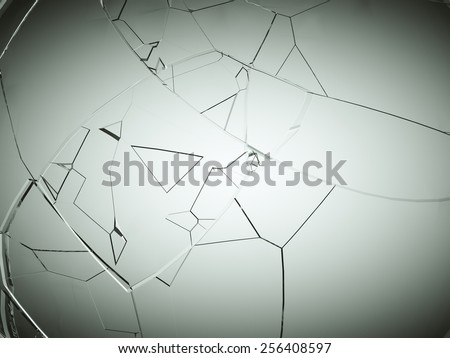 Splitted or cracked glass on grey vignetted background