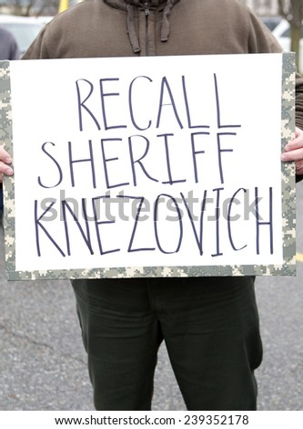 Spokane, Washington USA - December 20, 2014. A close up of a sign calling for a recall of Spokane, County Sheriff.