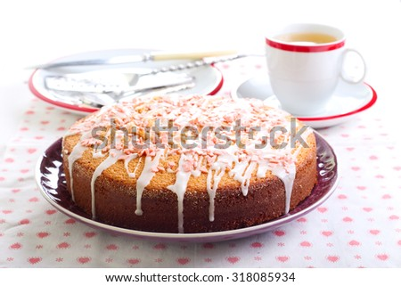 Sponge cake with lemon glaze and candy topping