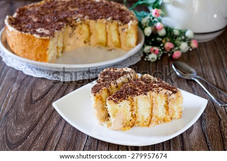Sponge cake with whipped cream and condensed milk - stock photo
