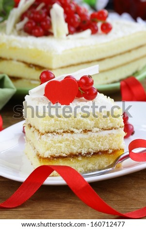 sponge cake with white chocolate, decorated with red currant