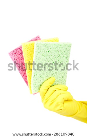 Sponge in hand with a rubber glove isolated on white background.