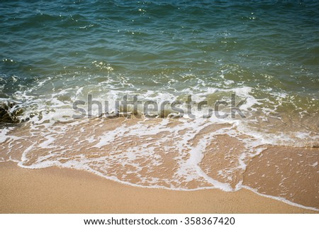 sponge water on the beach of thailand,soft wave of  sea on the beach,sponge water  - stock photo
