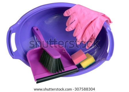Sponges, rag for cleaning, rubber gloves, dustpan and hand brush in plastic basin, isolated on white  - stock photo