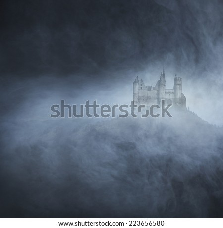 Spooky and ancient castle on the mountain. Halloween concept. - stock photo