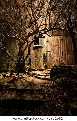 spooky barn with window at night - stock photo