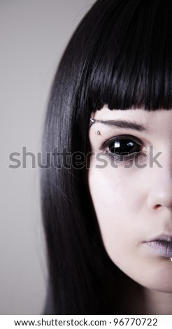 Spooky black eyed woman with pale skin, real sclera contact lenses - stock photo
