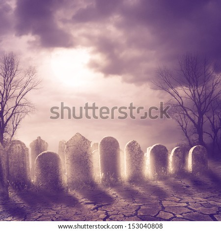 Spooky graveyard and moonlight - stock photo