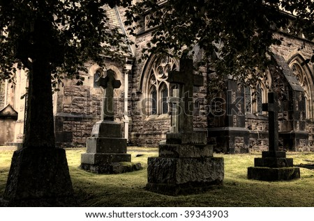 Spooky graveyard surrounding ancient church, Scotland - stock photo