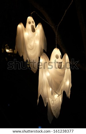 Spooky Halloween ghost against black background