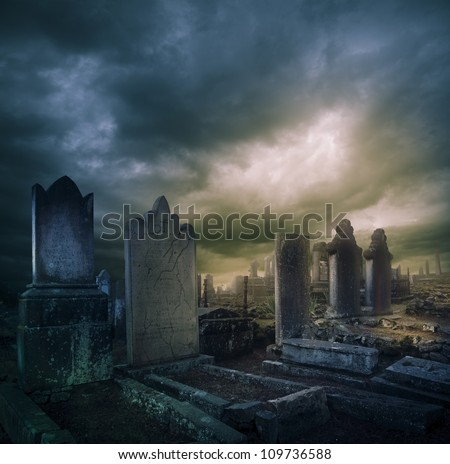 Spooky Halloween graveyard with dark clouds - stock photo