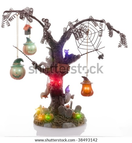 Spooky Halloween tree with Jack O'Lanterns, ghosts and cats.