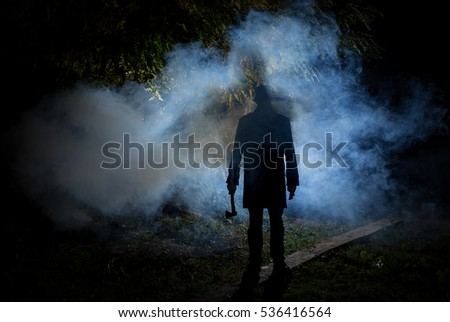 spooky man with smoke in background