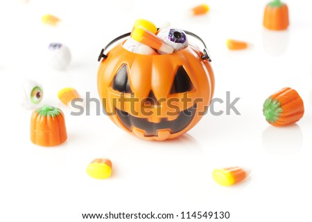 Spooky Orange Halloween Candy against a background