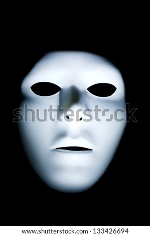 Spooky white ghostly face with big black eyes in the dark. - stock photo