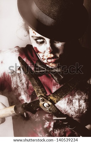 Spooky zombie slicing and dicing victims with gardening shears in midnight terror - stock photo