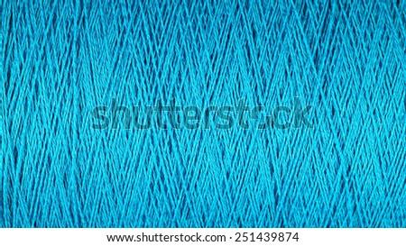Spool of blue thread macro  - stock photo