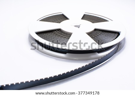 Spool of film strip of super 8 format - stock photo