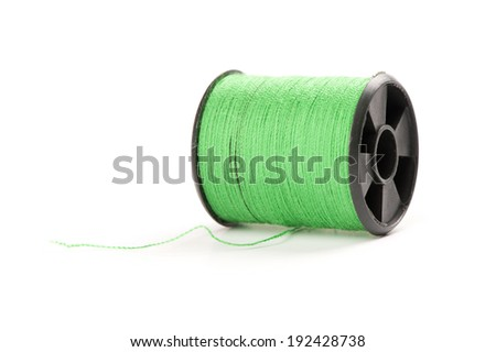 Spool of green thread isolated on white background