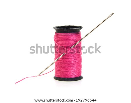 Spool of pink thread and needle isolated on white background  - stock photo