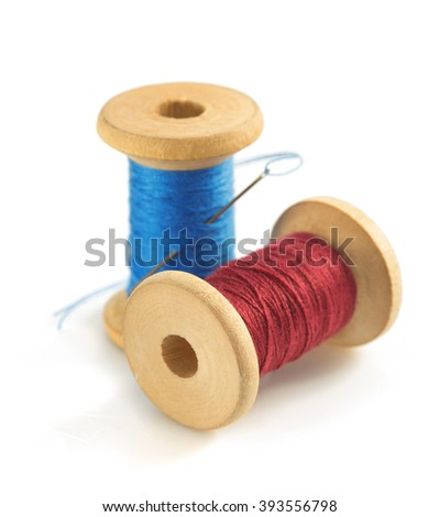 spool of thread and needle isolated on white background - stock photo