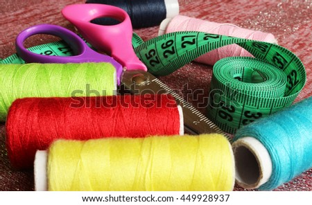 Spool of thread and scissors. Sewing accessories.