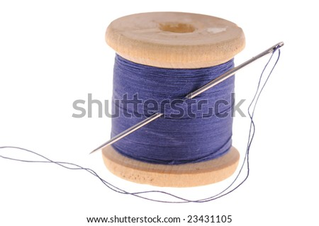 spool of thread and sewing needle, isolated on white background - stock photo