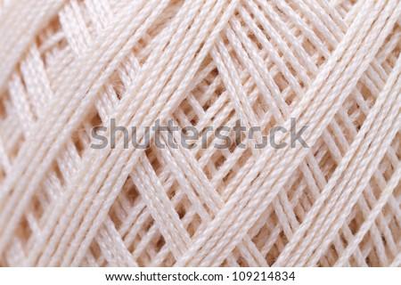 spool of thread macro texture - stock photo