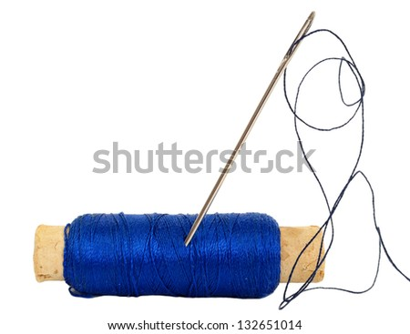 Spool of thread with needle - stock photo