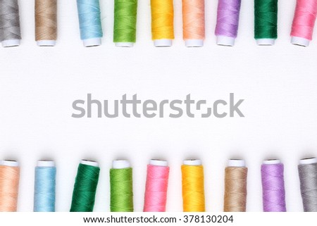 spool of threads on white background - stock photo