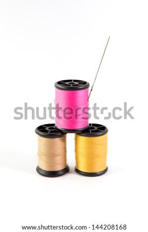 Spool thread and needle - stock photo