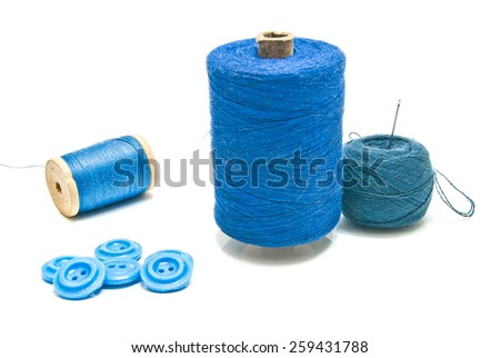 spools of thread and ball of yarn on white background - stock photo
