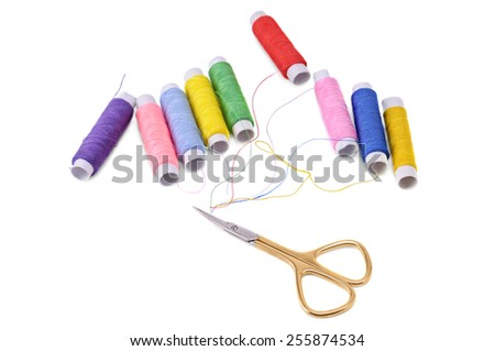 spools of thread and scissors isolated on white background - stock photo