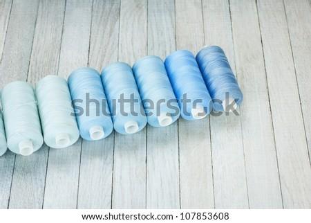 spools of thread, bright background - stock photo