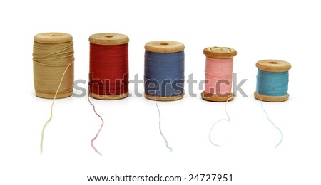 Spools of thread isolated on white. - stock photo