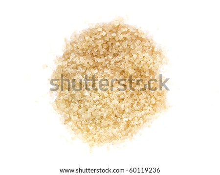 spoon and cane sugar on white background - stock photo