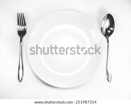 spoon and dish on white background