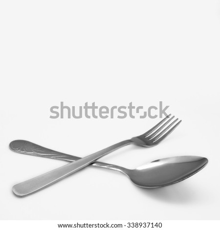 spoon and fork on a white background