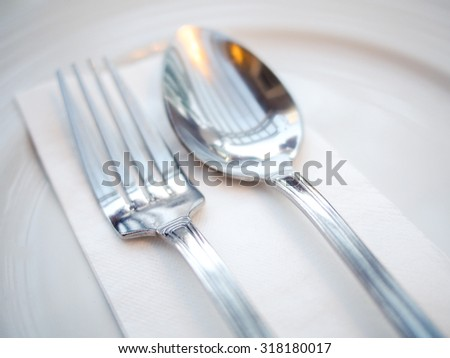 spoon and fork on plate
