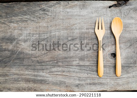 spoon and fork on the wood background