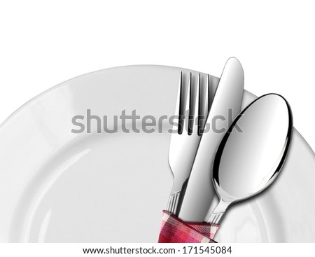 Spoon and Fork with Knife on a Plate - stock photo