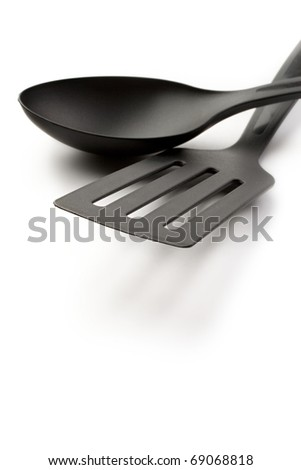 Spoon and spatula isolated on white - stock photo
